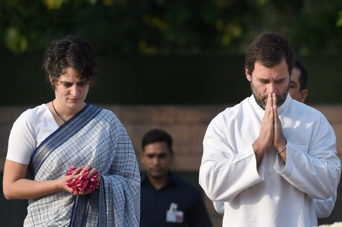 Rahul Gandhi and Priyanka Gandhi pay homage to their father, former prime minister Rajiv Gandhi, on his 25th death anniversary, at his memorial, May 21, 2016. Photograph: Manvender Vashist/PTI