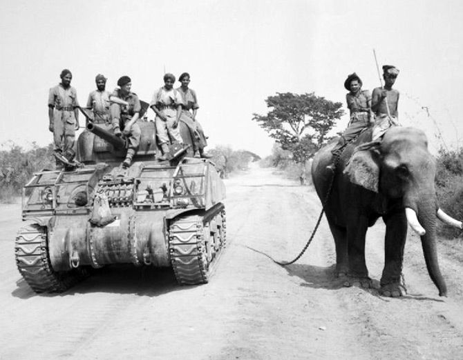 The British commander and Indian crew of a Sherman tank of the 9th Royal Deccan Horse, 255th Indian Tank Brigade, encounter a newly liberated elephant on the road to Meiktila, Burman, March 29, 1945. Photograph: Sergeant A Stubbs/ No 9 Army Film & Photographic Unit, from the collection of the Imperial War Museum.