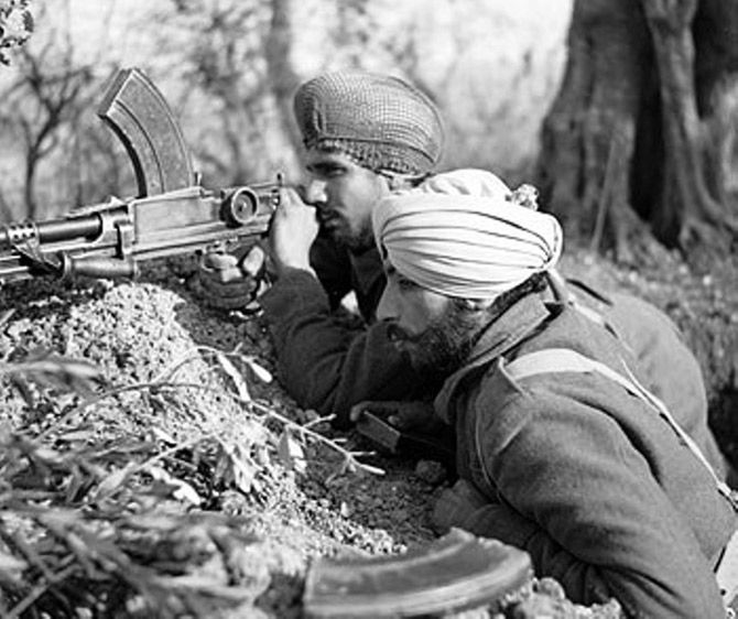 Two Sikh soldiers from the Indian Army use a Bren light machine gun in the Italian campaign near Villa Grande, January 15, 1944. Photograph: Sergeant Loughlin/ No 2 Army Film & Photographic Unit, from the collection of the Imperial War Museum