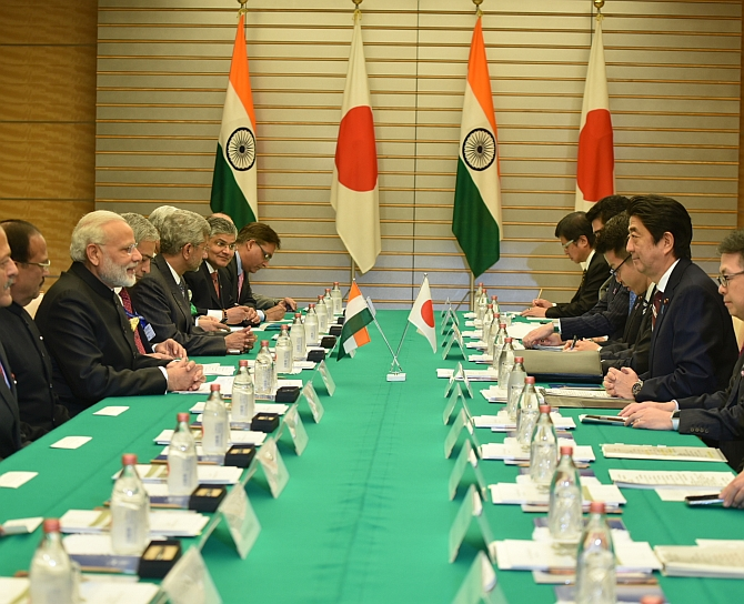 Prime Minister Narendra Modi and Japan Prime Minister Shinzo Abe with their respective delegations.