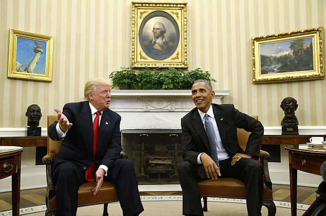 Presidents Donald Trump and Barack Obama in the Oval Office