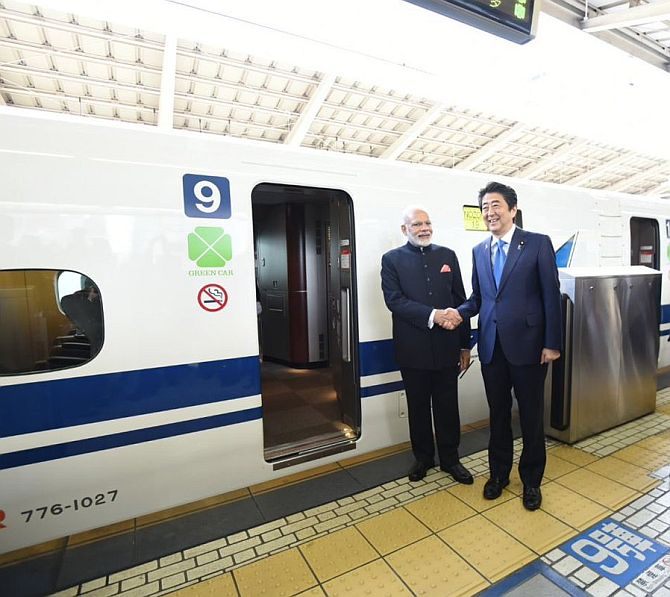 Prime Minister Narendra D Modi and Japanese Prime Minister Shinzo Abe travelled in Japan's famed high-speed Shinkansen bullet train, November 12, 2016. Modi and Abe travelled in the train, whose speed ranges from 240 kms per hour to 320 kms per hour, from Tokyo to Kobe. Photograph: MEASpokesman/Twitter