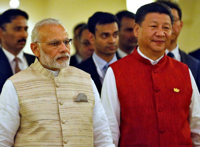 Prime Minister Narendra D Modi and Chinese President Xi Jinping at the 8th BRICS summit in Goa, October 2016.