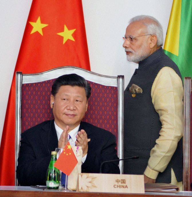 Prime Minister Narendra Modi and Chinese President Xi Jinping at the BRICS summit in Benaulim, Goa, October 2016. Photograph: PTI Photo