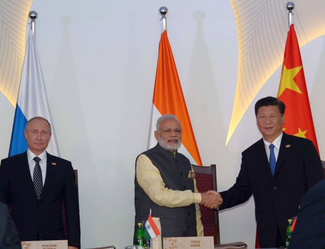 IMAGE: Prime Minister Narendra Modi with Chinese President Xi Jinping and Russian President Vladimir Putin at the BRICS summit in Goa. Photograph: BRICS/Facebook