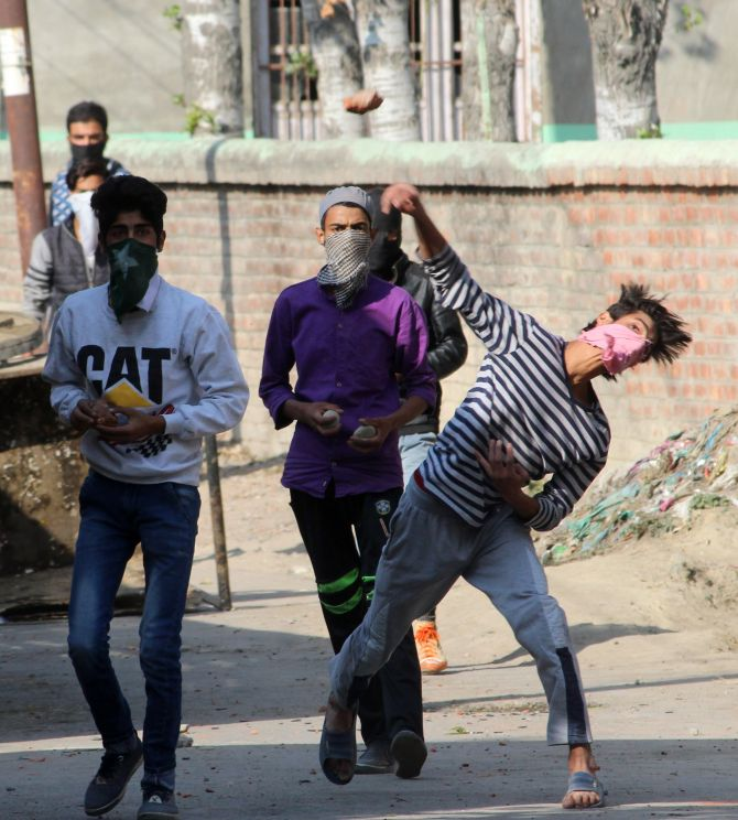 Kashmiri youth throw stones at the police, October 21, 2016. Photograph: Umar Ganie