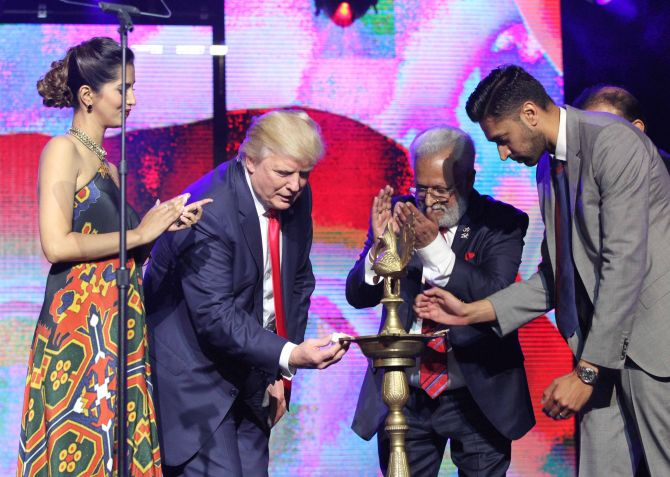 Donald Trump lights the ceremonial lamp to inaugurate the Republican Hindu Coalition event in Edison, New Jersey, October 15, 2016.