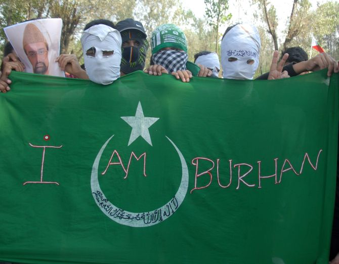 Protesters carry a banner reading 'I am Burhan'. Photograph: Umar Ganie/Rediff.com