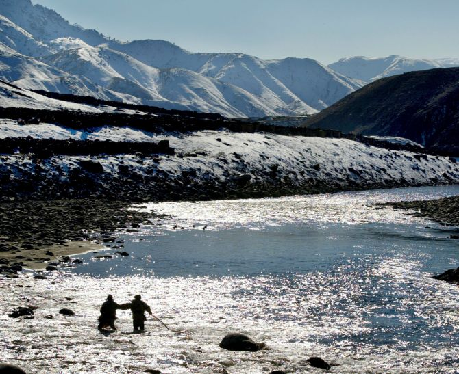 The Panjshir river with the Hindu Kush mountains in the background.