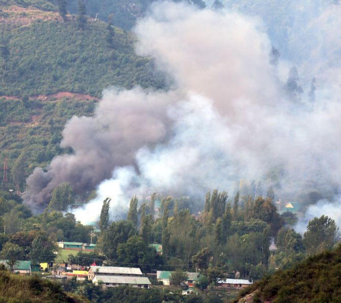 Smoke rises from the Uri Brigade camp during the September 18, 2016 terror attack. Photograph: Umar Ganie