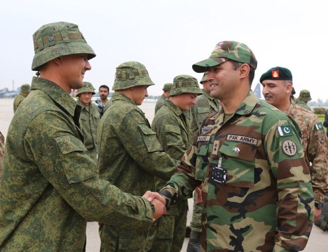 Russian and Pakistani soldiers at the military exercise. Photograph: @AsimBajwaISPR/Twitter