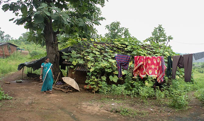 Mamta, outside her ramshackle hut in Pethranjani village, Mokhada, which is wellc-onnected with roads to Mumbai. Despite better connectivity the couple's annual earnings fluctuate between Rs 9000-13,500, which we spend these days to buy a smartphone.