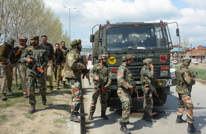 Soldiers cordon off an area after their convoy was attacked by terrorists in Srinagar
