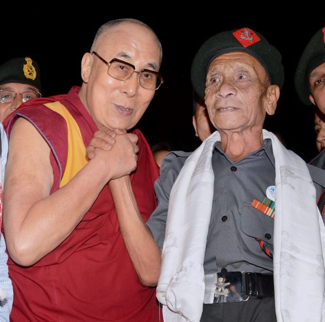 His Holiness The Dalai Lama with retired Havaldar Naren Chandra Das, one of the five Assam Rifles soldiers who escorted him to India during his escape from Tibet in March 1959. Photographs: PTI Photo