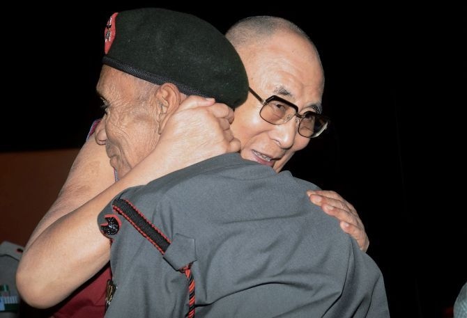 Dalai Lama and soldier