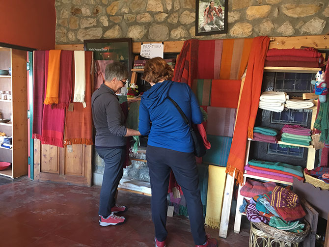 Hand-woven shawls displayed in the shop