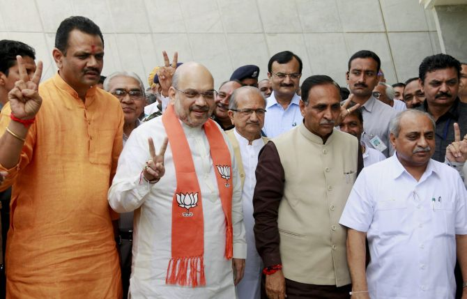 From left, BJP Gujarat President Jitu Vaghani, BJP national President Amit Shah, Gujarat Chief Minister Vijay Rupani and Deputy Chief Minister Nitin Patel, August 9, 2017. Photograph: PTI Photo