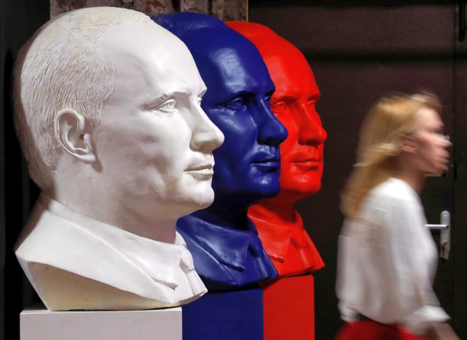 Busts depicting Russian President Vladimir Putin in the colours of the Russian flag at the SUPERPUTIN exhibition. Photograph: Maxim Shemetov/Reuters