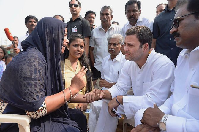 Rahul Gandhi meets with the families of fishermen affected by Cyclone Ockhi in Kanyakumari, December 14, 2017. Photograph: PTI Photo