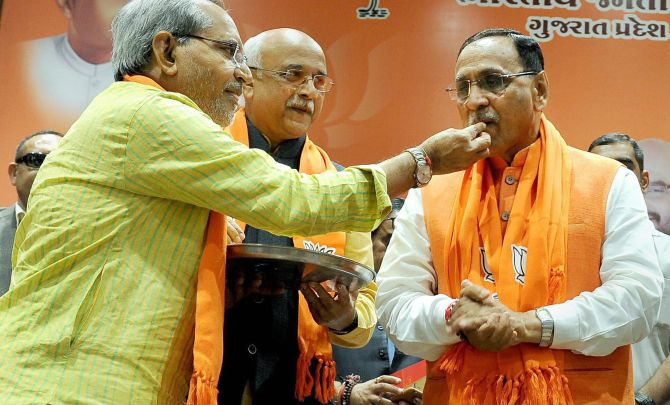 Will Vijay Rupani keep his job after a close fight?