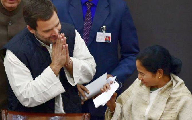 Rahul Gandhi greets Mamata Banerjee. Photograph: PTI Photo
