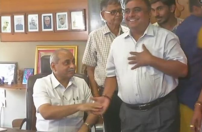 Nitin Patel gets finance after Shah intervenes; assumes charge