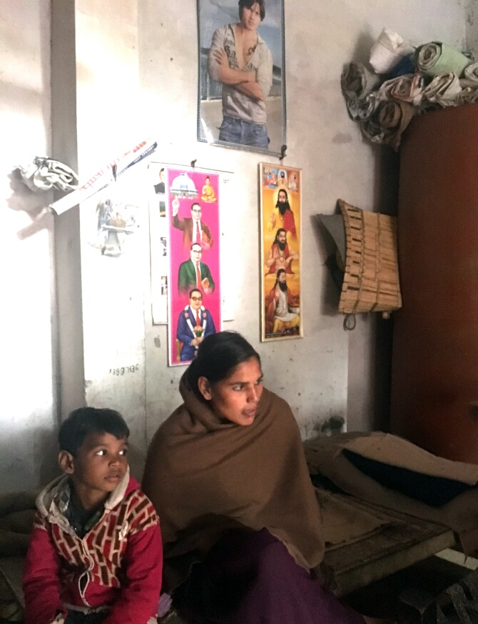 Usha Rani in her home with posters of Shahid Kapur, Ambedkar and ant Ravi Das
