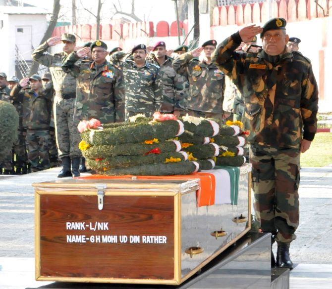 General Bipin Rawat, the chief of the army staff, pays homage to a soldier martyred in Kashmir. Photograph: Umar Ganie for Rediff.com
