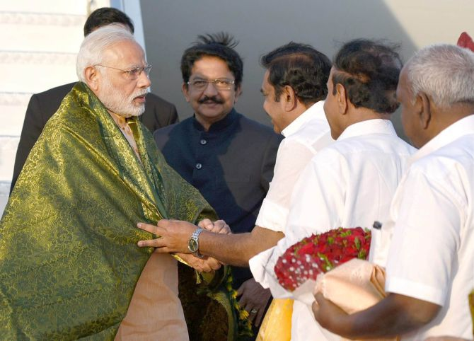 Prime Minister Narendra D Modi welcomed by Tamil Nadu Chief Minister Edappadi K Palaniswami in Coimbatore, February 24, 2017.