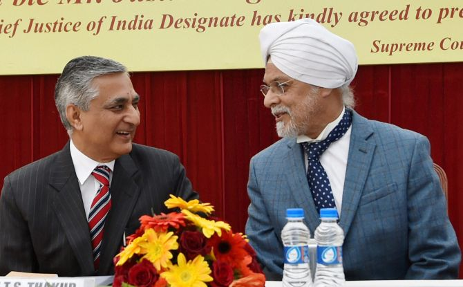 Outgoing Chief Justice of India Justice T S Thakur with CJI-designate Justice J S Khehar at his farewell ceremony in New Delhi on Tuesday, January 3, 2017. Photograph: Atul Yadav/PTI Photo
