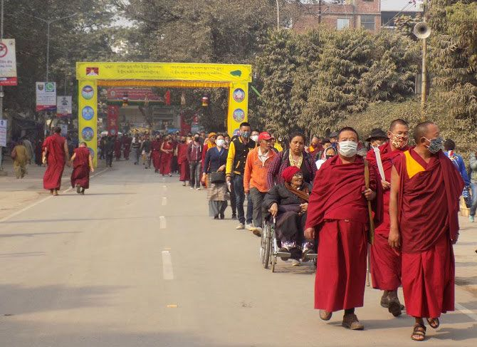 Monks and others on their way to the venue of the Kalachakra Puja
