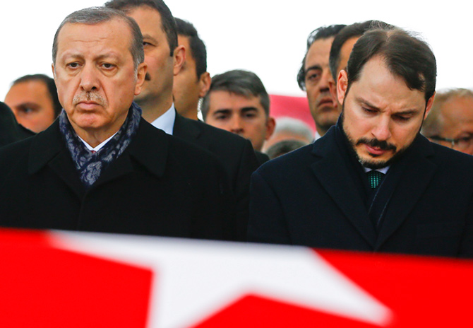 Turkish President Tayyip Erdogan, left, accompanied by Energy Minister Berat Albayrak, at the funeral of police officer Hasim Usta who was killed in an Istanbul terror attack, December 12, 2016. Photograph: Osman Orsal/Reuters