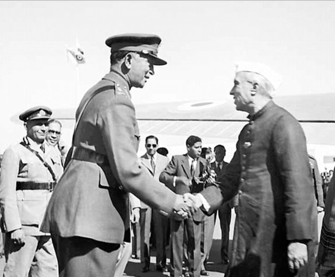 General K M Cariappa greets Prime Minister Jawaharlal Nehru