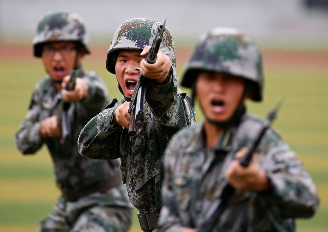 People's Liberation Army soldiers at a drill in Beijing. Photograph: Peter Kujundzic/Reuters