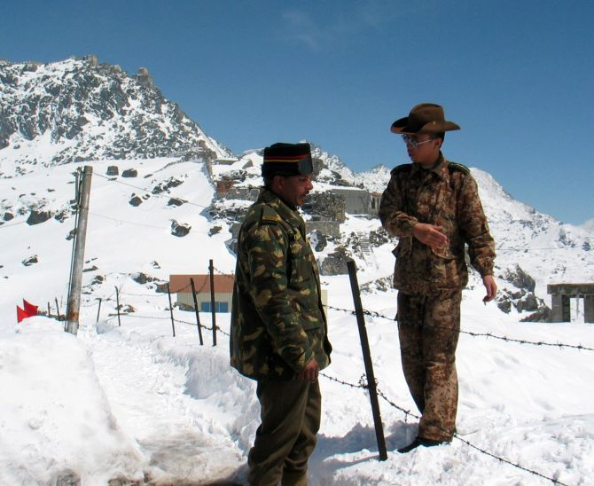 Indian and Chinese soldiers in friendlier times at Nathu La in Sikkim