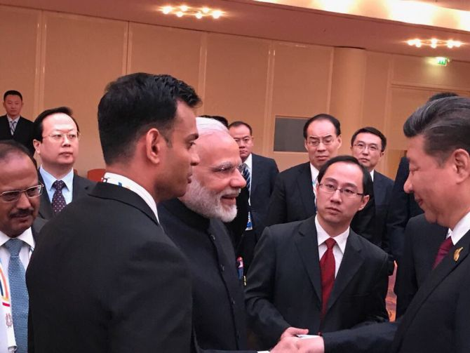 Prime Minister Narendra D Modi greets Chinese President Xi Jinping at the BRICS leaders' informal gathering on the sidelines of the G20 summit in Hamburg, Germany, July 7, 2017. Photograph: @MEAIndia/Twitter