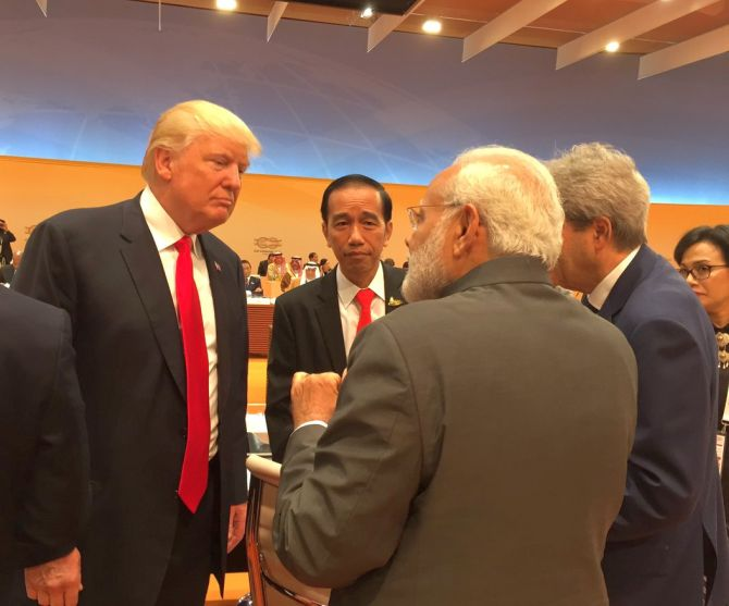Prime Minister Narendra D Modi chats with US President Donald J Trump at the G-20 summit in Hamburg, July 8, 2017. Photograph: Kind courtesy Arvind Panagariya