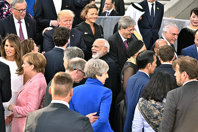 Prime Minister Narendra Damodardas Modi with United States President Donald John Trump and Canadian Prime Minister Justin Trudeau at the G-20 summit in Hamburg, July 7, 2017. Photograph: Press Information Bureau