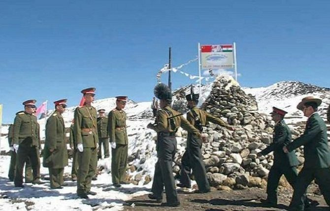 Indian Army officers, right, arrive for a meeting with the Chinese counterparts at the LAC