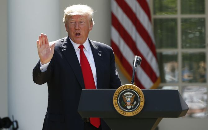 US President Donald Trump announces his decision that the United States will withdraw from the Paris Climate Agreement, June 1. Photograph: Kevin Lamarque/Reuters