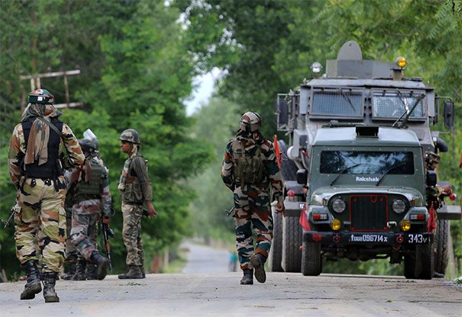 Soldiers rush towards the site of an encounter at a Central Reserve Police Force camp in Bandipore, south Kashmir, June 5, 2017. Four terrorists were slain in the firefight. Photograph: Umar Ganie for Rediff.com