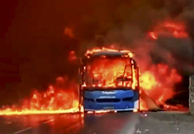 A bus in flames after it was torched by farmers on the Bhopal-Indore highway in Dewas, Madhya Pradesh, during the farmers agitation in MP in June 2017. Photograph: PTI Photo