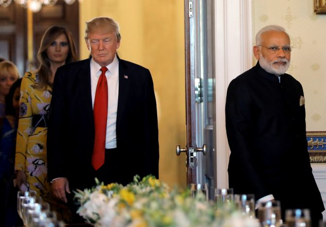 Prime Minister Narendra Modi, US President Donald Trump and First Lady Melania Trump arrive for a dinner at the White House. Photograph: Carlos Barria/Reuters