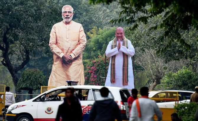 Cut-outs of Narendra Modi and Amit Shah outside party headquarters in Delhi
