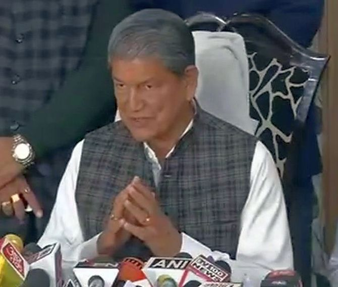 After drubbing in U'khand polls, Harish Rawat resigns