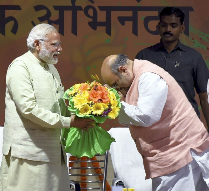 BJP President Amit Shah greets PM Modi at the victory rally, March 12, 2017. Photograph: Kamal Singh/PTI Photo
