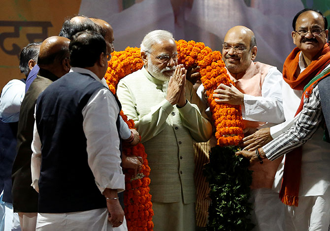 Narendra Modi felicitated by senior Bharatiya Janata Party leaders during a victory ceremony at the BJP headquarters in New Delhi, March 12, 2017. Photograph: Adnan Abidi/Reuters