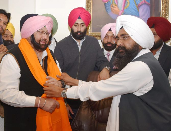 Amarinder keeps home portfolio; Sidhu gets local govt