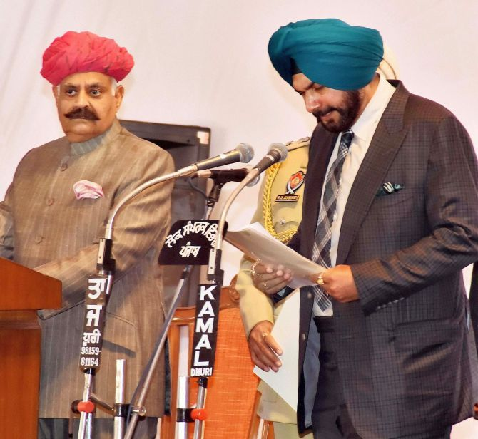 Navjot Singh Sidhu takes the oath as a minister in the Amarinder Singh government, March 16, 2017. Photograph: PTI Photo