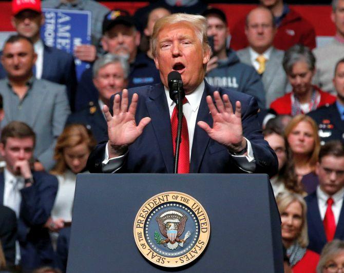 Trump calls federal judge's travel ban block an 'unprecedented judicial overreach'